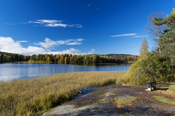Autumn lakes at Norway bench on coast