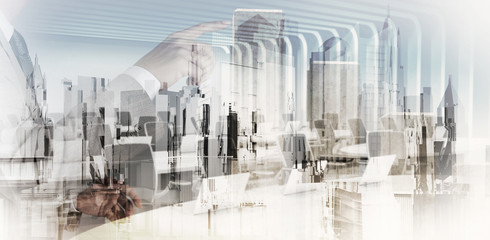 Double exposure of businessman hand working with new modern comp