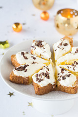 Pandoro slice with cream filling and chocolate chips
