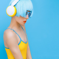 sensual DJ-lady in style headphones listening to music