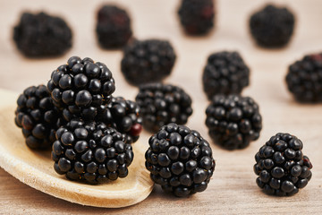 Blackberries scattered on a table