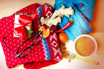 still life with red knitted sweater, socks, sunglasses and other Wall mural