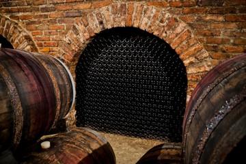 Fototapete - Bottles in wine cellar