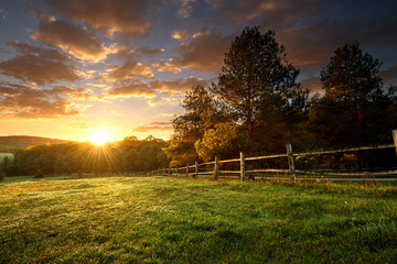 Poster Culture Picturesque landscape, fenced ranch at sunrise