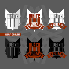 Black wolf and white wolf emblems