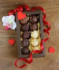 chocolate candies (truffles) of white and dark chocolate