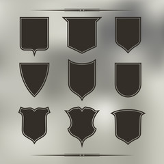 Set of nine  different forms of shields. Black with contour
