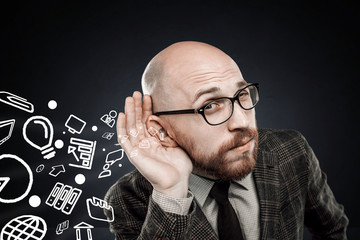 man listens to a large flow of information