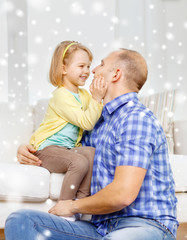 smiling father and daughter hugging at home