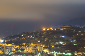 City under mountain at night