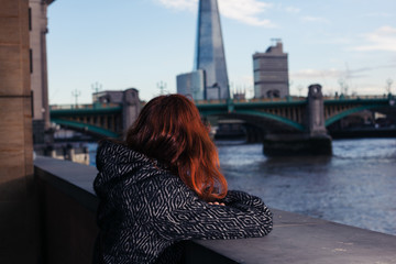 Woman looking at river Thames