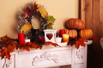 Festive autumn decor on fireplace