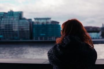 Woman looking at river Thames