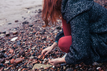 Young woman beachcombing in city