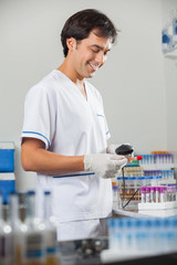 Technician Scanning Barcode On Test Tube