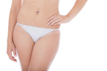 Attractive female body. All on white background.
