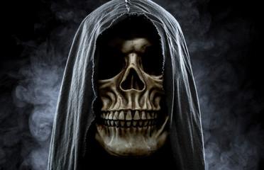 Grim reaper, portrait of a skull in the hood over black, foggy b