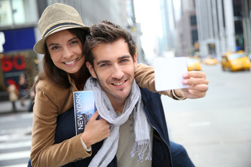 Tourists in Manhattan showing New York pass