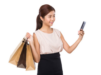 Woman with shopping bag and take selfie