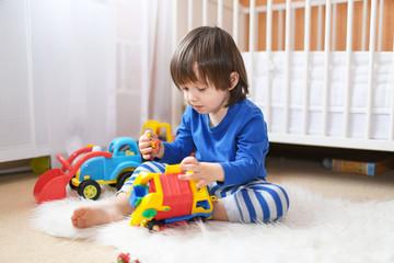 little boy plays cars