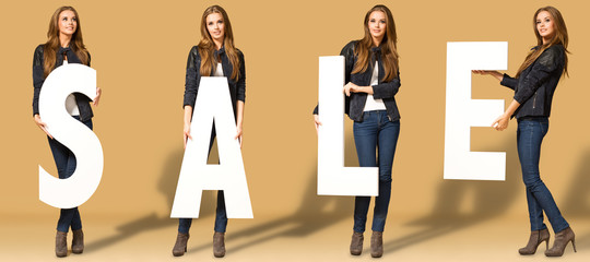 Young woman with sale letters Wall mural