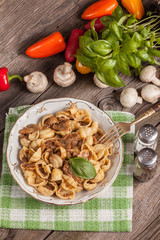 Pork stew with mushrooms, basil and red pepper.