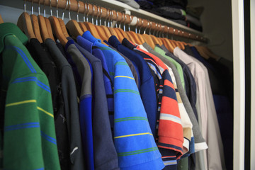 Man Shirts hanging in the closet