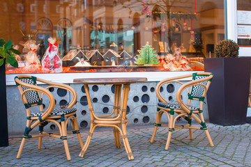 Outdoor cafe in european city at Christmas time