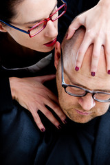woman whispering nastily venom in man's ear