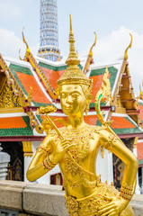 Golden Kinnari statue at the temple of the Emerald Buddha