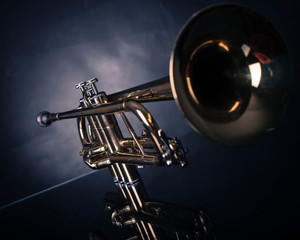 Trumpet in front of blue wrinkled background