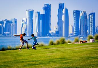 Boys playing football in Doha qatar