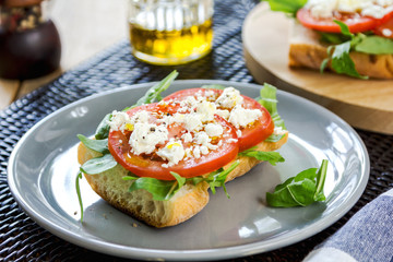 Feta with tomato and rocket sandwich