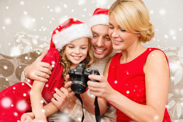 happy family with digital camera at home