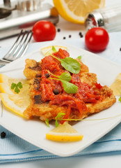 Fried fish with vegetable sauce.