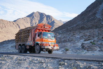 Decorative old   truck with Karakoram mountain range in the back