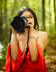 Young woman photographer outdoor