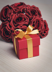 red flowers and gift box with yellow ribbon
