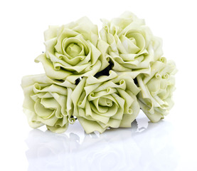 artificial bouquet of green roses on a white background