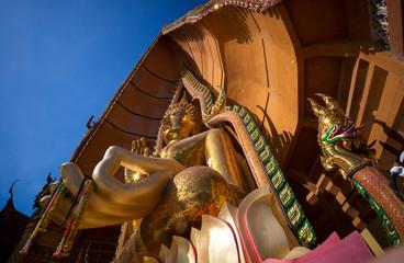 Big golden Buddha in temple, Kanchanaburi