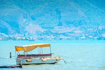 Aluminium Prints Indonesia small old sea vessel moored near the shore