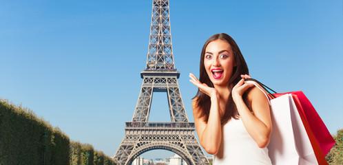 Beautiful girl with shopping bags in Paris