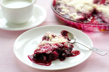 Berry pie and cup of milk