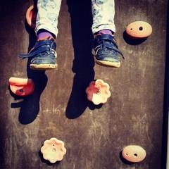 Child climb legs wall background fun play