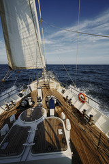 Yacht Sailing against sunset. Sailboat. Sailing