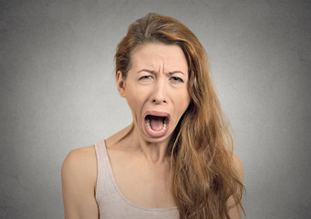 Headshot angry upset woman screaming crying grey background