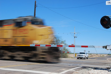 Diesel locomotive passing through railroad crossing