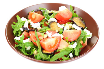 Eggplant salad with tomatoes, arugula and feta cheese, isolated