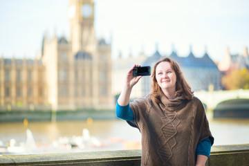 Tourist in London doing selfie