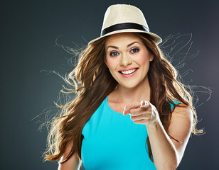 fashion style portrait of young smiling woman points a finger a